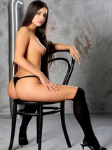 Natalia pose naked on the chair