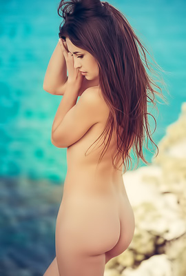 Cutie undresses on rock